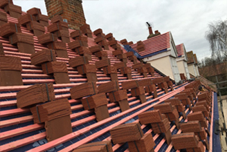 Clay tiled roof by JRM Roofing